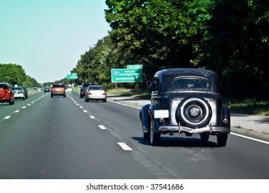 Old Black Car Driving