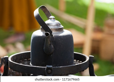 Old black coffee pot outdoors
