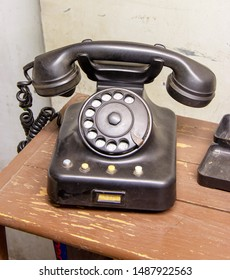 old black dial telephone of the 80s in a office