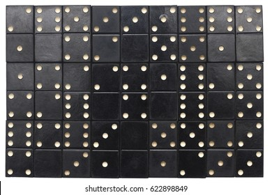 old  black dominoes tiles background closeup