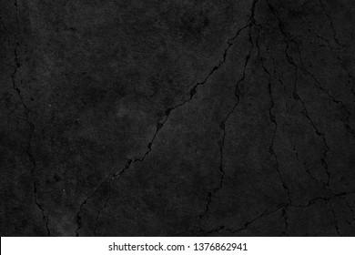Old black grunge background. Crack on concrete wall. Nice bacground