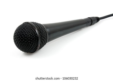 Old black  microphone with cable over white background