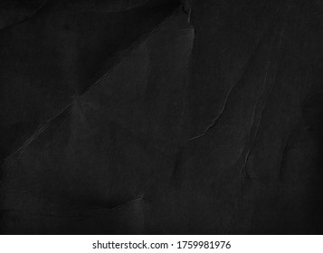 Old black paper texture background. Fold page. Grunge