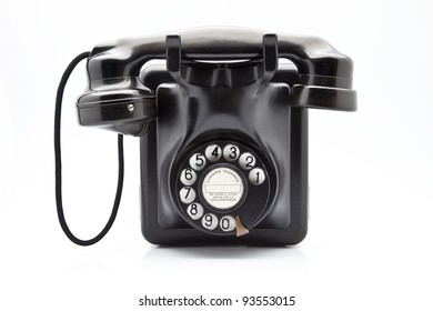 old black phone with dial disk