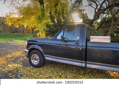 Old Black Pickup Truck on an Autumn Day at Sunrise