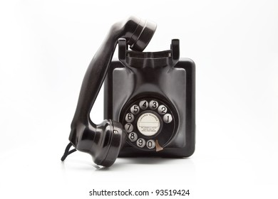 old black telephone dial disk