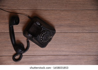Old black telephone with numbers