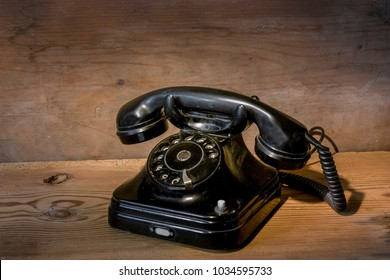 old black telephone on wood