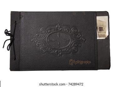 Old, black vintage photo album isolated on white.