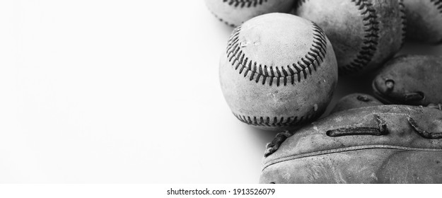 Old black and white baseball equipment from game with texture of balls on banner background.