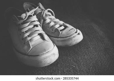 Old black and white sneakers