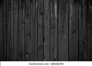 Old black wood. Blackboard. Dark background. Grunge texture