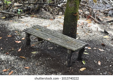 Old black wooden chair located on the black sand beach in Trat, Thailand