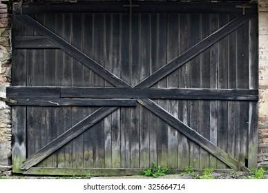 Old black wooden gate