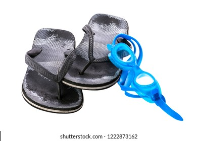 Old black worn boy's sea slippers isolated on white background. Glasses for the sea. White background.