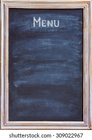 Old blackboard with white chalk and eraser for menu or price.
