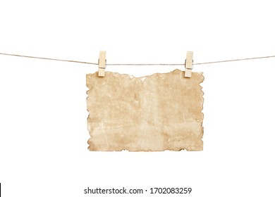 Old blank brown paper texture with burned edges patterns hanging in wood clothes pins and brown rope isolated on white background