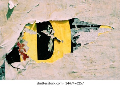 Old blank colorful grunge ripped torn street posters crumpled paper background urban wall empty space for text