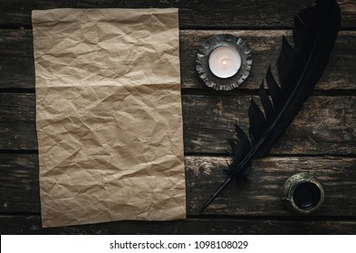 Old blank letter paper page on the aged wooden background. Manuscript. Back to school or poem writer desk table concept.