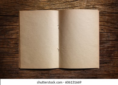 Old blank paper notebook on wooden table. Background.
