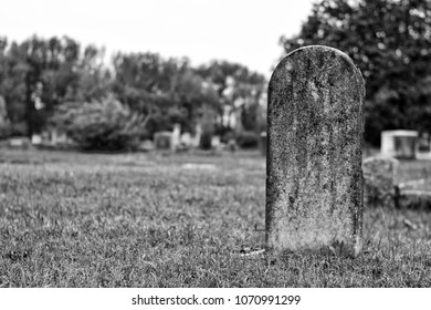 Old blank tombstone in black and white.