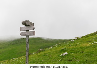 Old Blank Wooden Signpost on a mountain path