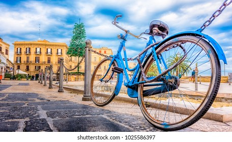 Old blue bicycle with the old town in the background, Bari, Puglia, South Italy