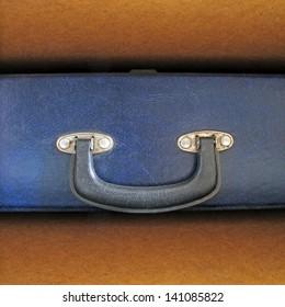 old blue briefcase in wooden shelf