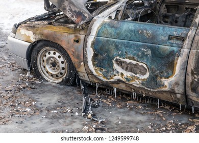 Old blue car after fire. Arson car for the sake of insurance. Rusty burnt metal close up. Burnt texture. Car insurance and restful sleep.