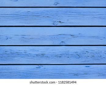 Old blue cracked wood planks.