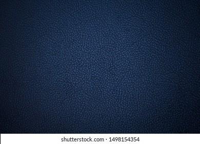 Old blue dermantine. Artificial dark skin. Close-up. Background. Texture.