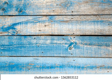 Old blue distressed wooden wall background or texture