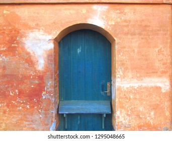 Old Blue Door in Brick Wall