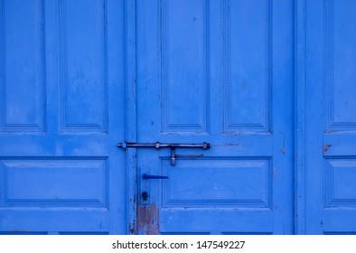 Old Blue Door with Metal Bolt