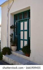 old blue door on a village street in Сyprus