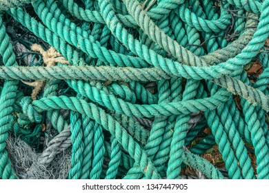 Old blue frayed ship rope at fishing village in Nha Trang, Vietnam.