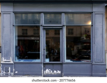 Old blue gray shop front in Paris.
