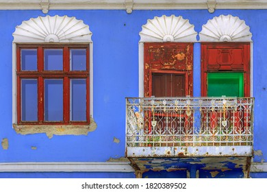 old blue house with red windows