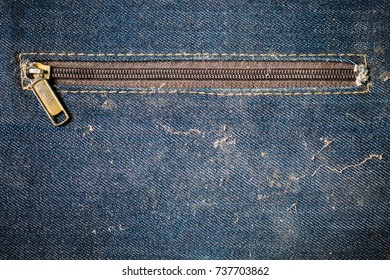 Old blue jeans bag dirty and more dust with stain unzipped.