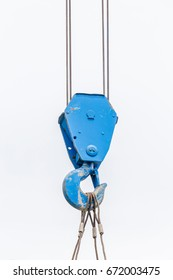 The old blue lifting crane hook is used in construction site on white background.