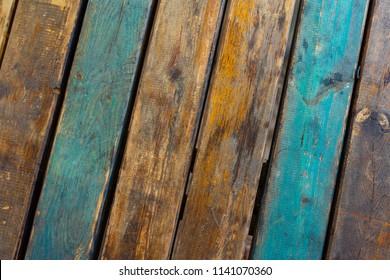 Old blue and orange floorboards. Floorboard texture