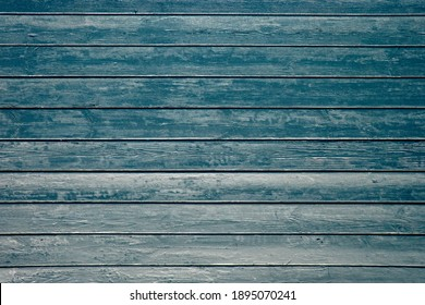 Old blue painted rustic wooden planks wall