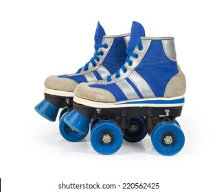 Old blue roller skates isolated on white background