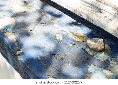 Old blue window sill. Shadow of tree on window sill