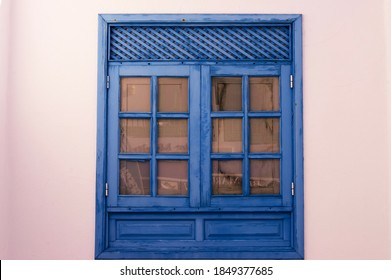 Old blue window, wood and white wall. Mediterran Setting