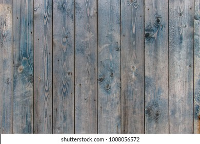 An old blue wooden fence