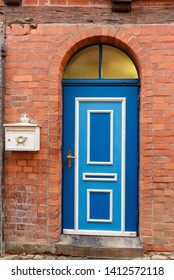 Old blue wooden front door in house in Luneburg. Germany