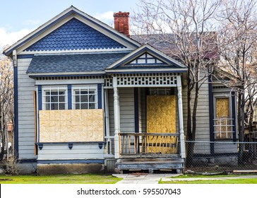 Old Boarded Up Home From Recession