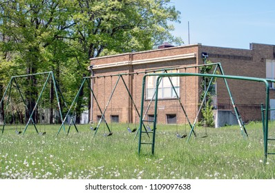 old boarded up  school and abandoned  play yard