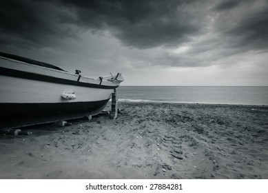 Old boat abandoned at the beach